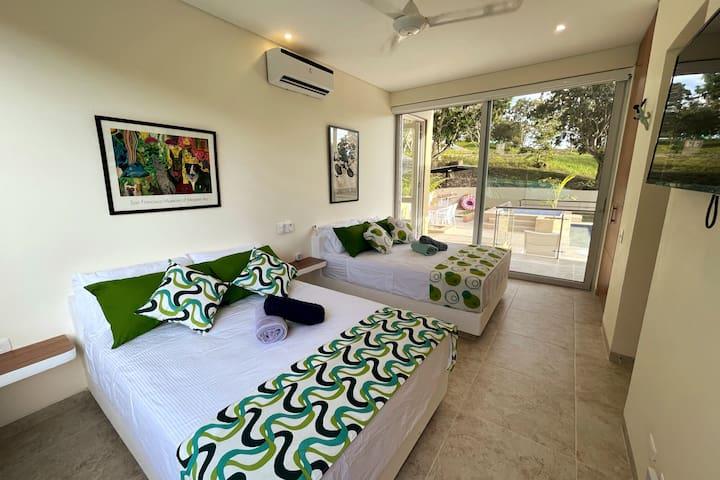 Alcoba #3, con dos camas nuevas y comodas, y con A/C, closet, TV, wifi, ventantas con blackout y bano.