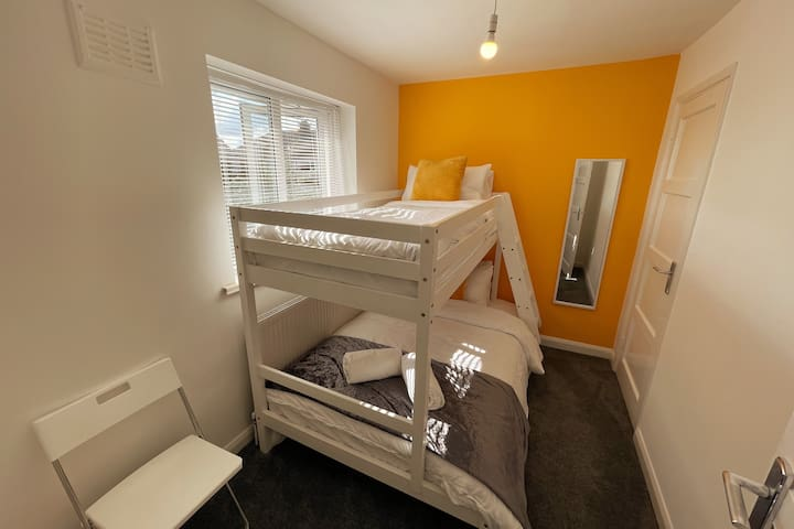 Bedroom 3 - Bunk Bed with x 1 Single Bed and x 1 Double Bed, with desk, side drawers and wardrobe space.