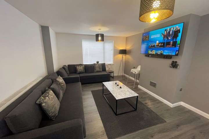 """Large Living Room Space - with 58"""" Sky+ Ultra HD TV inc Sky Sport, Sky Movies, Netflix and Disney+  PLUS Sound System - Bluetooth to connect to mobile device. Alexa to control Smart TV a and HIVE Smart Central Heating.  Also includes x2 Sofa Bed"""