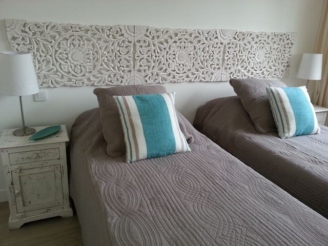 The second bedroom has two singles which can be made into a king-size bed.