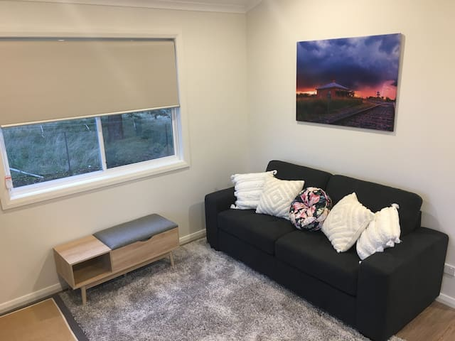 Comfortable brand new 3 seater sofa ideal for relaxing in front of the TV or enjoying the view through the full length glass doors.