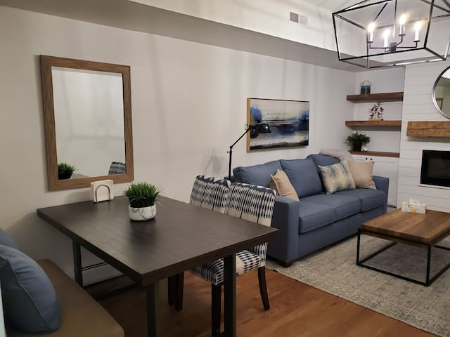 Cozy up in the living room for dinner or watching movies. The living room features an electronic fireplace and pull out sofa bed.