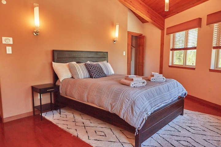 Bedroom 3 on the Southside of the Haus featuring a Queen sized Bed. Spacious closet awaits you with a view!