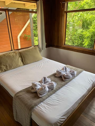 Second bedroom features a double bed and mountain views