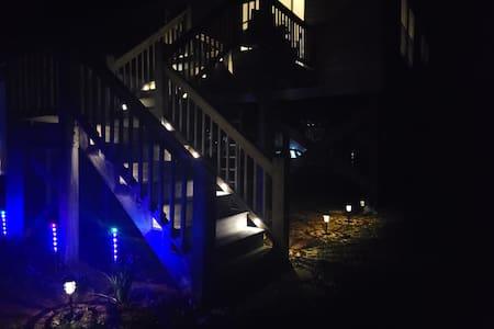 Driveway parking and illuminated stairway.