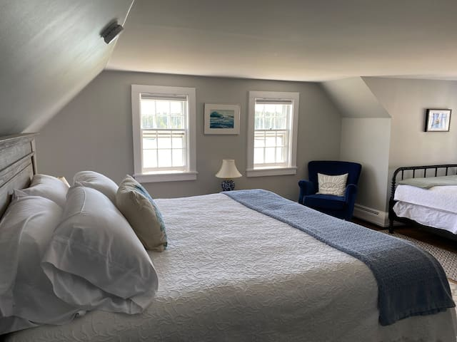 Harborside bedroom with new king bed and daybed.