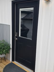 """36"""" wide accessible entry with porch light and lever handle."""