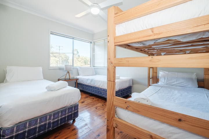 The third bedroom is fitted with two comfortable single beds and bunk beds, accommodating four guests. This is a great space for kids or those travelling in a group.