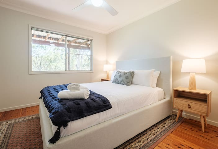 A second bedroom is replete with plush queen bed, ceiling fan and extra blankets to keep you cosy
