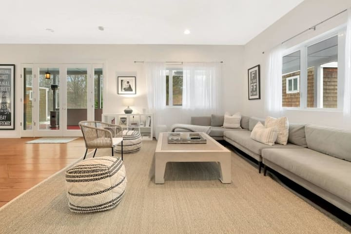 The living room located on the Main Level of the house has a comfy sofa and a huge seating area