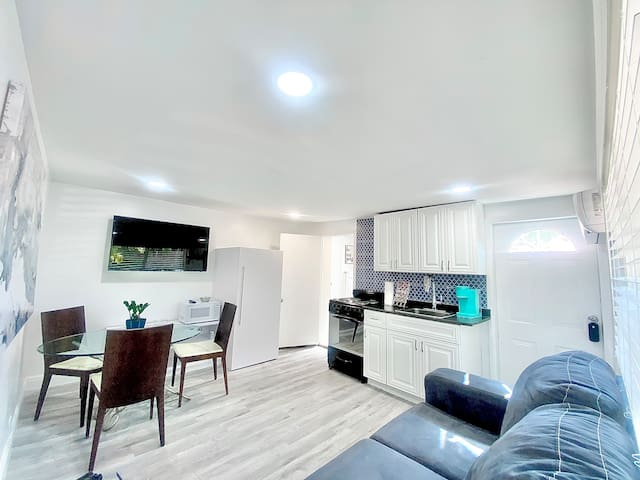 Living Room Area; Pullout Couch (Queen Size Bed); Pool Area View; Entrance door to Unit; Nice Kitchen