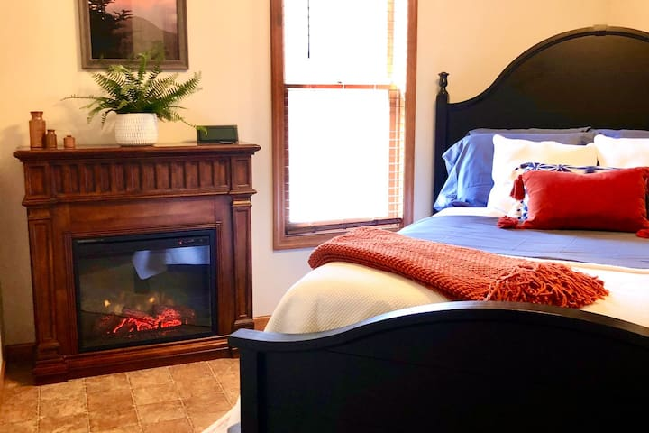 Queen size bed with beautiful view of the pond.  Electric fireplace that functions with or without heat.  Clock with usb attachment.  Bedroom intentionally does not have a door to allow for a more open floor plan