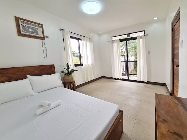 Bedroom 2 on the 2nd floor has a double size bed and air conditioned