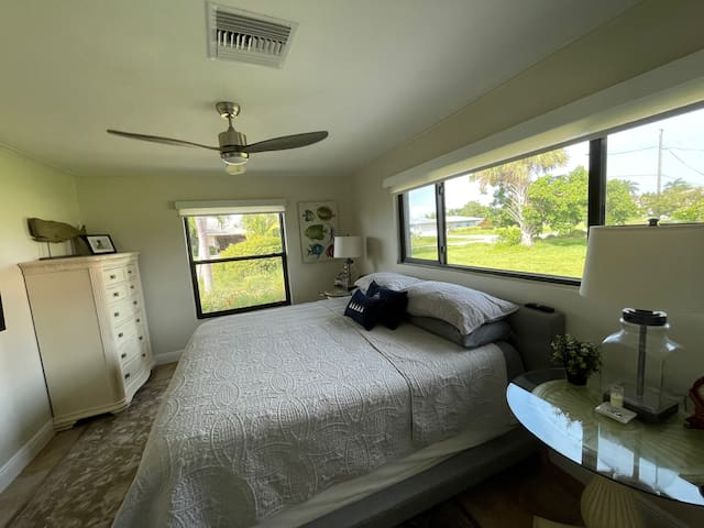 In-law-suite bedroom w King-bed and 180-degree views.