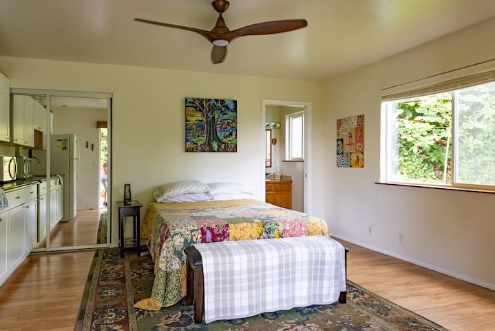 This supersized suite + large patio has a comfy queen bed, full bath with shower, a large closet, and a coffee bar + fridge for keeping everything cold for your beach days!  All surrounded by lush trees and vegetation.