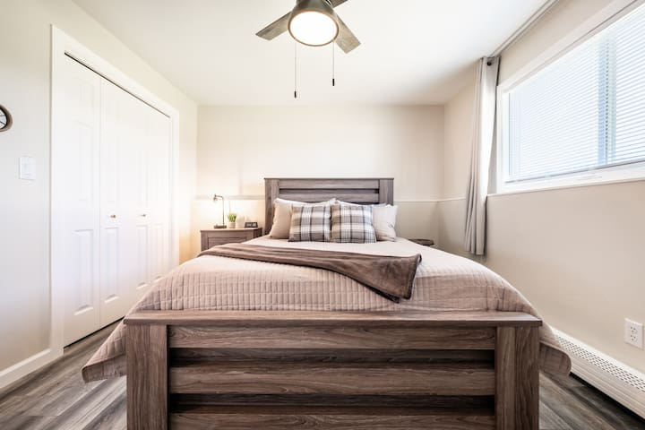 The master bedroom at the Deer Lookout has both blinds for privacy as well as blackout curtains. Don't forget to open them - or you might miss a spectacular view of Pike's Peak!
