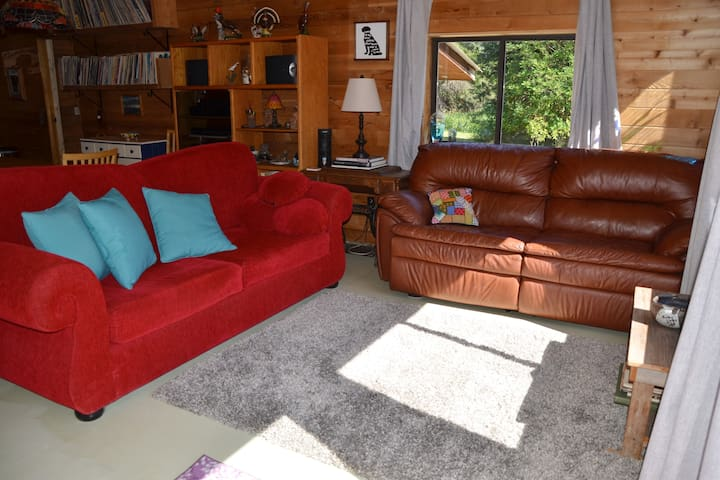 Family room (stereo with LPs & CDs in the background).