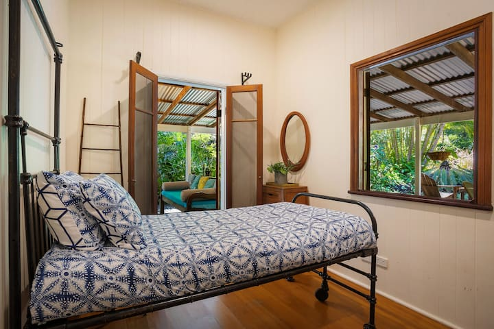 The third bedroom is fitted with a comfortable single bed. It boasts an oversized window and direct veranda access allowing plenty of natural light.