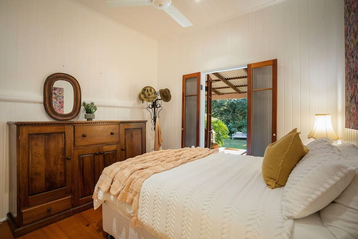 The gorgeous second bedroom has a queen-sized bed topped with luxury linens for a good night's sleep. There is drawer space for your belongings.