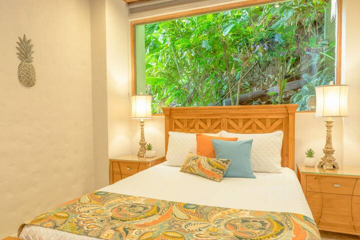 Jungle Suite (Bedroom #5) with Queen bed, attached private bath, giant jungle window