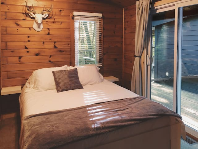 Queen bed with private walk-out to elevated deck.
