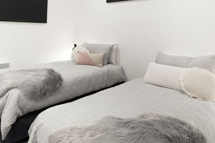 Bedroom 2 can be configured as another king bed or 2 or 3 single beds.
