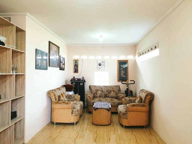 Living Room - Sofas, stereo sound system and gym equipment are available
