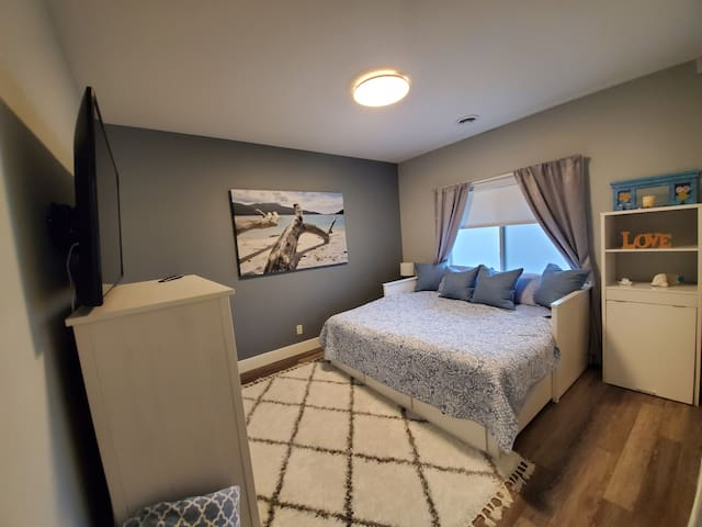 Bedroom #3 with a King and plenty of room and great big screen with internet TV for chill time
