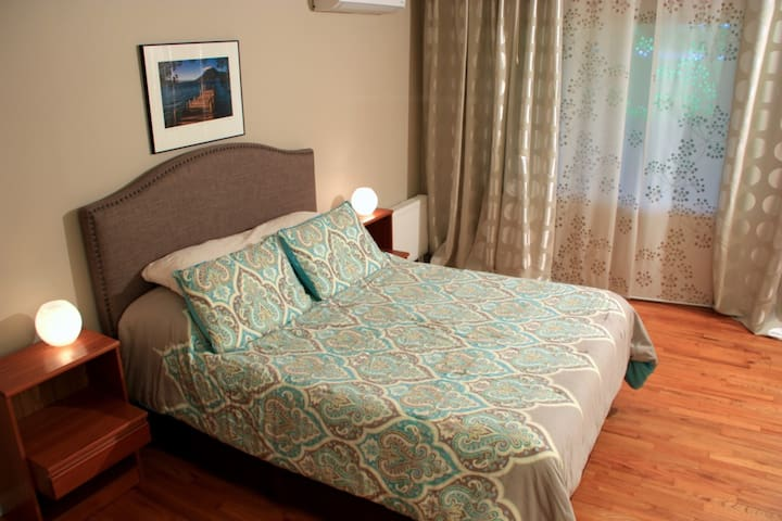 The Giardion Bedroom, large 18x14 room with on-suite bath & large picture window on 1st floor of house.