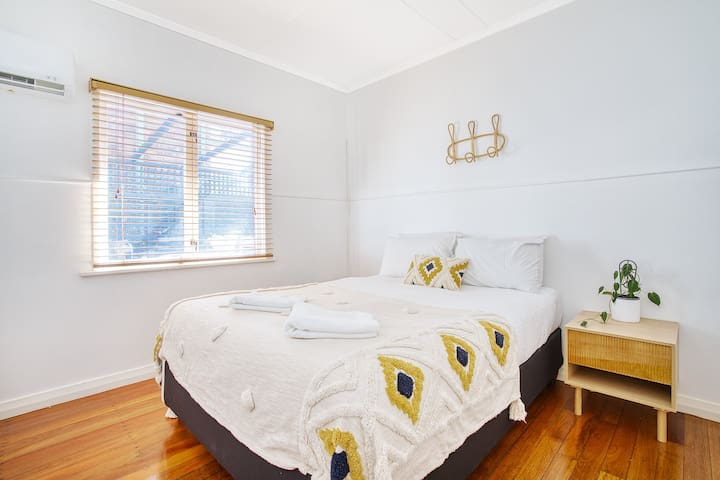 Two spacious bedrooms offer queen beds, polished hardwood flooring and loads of natural light from the large windows.