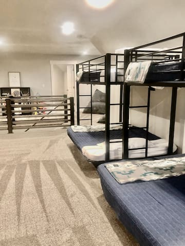 Open bunk room, play area for small children, and second gathering area.