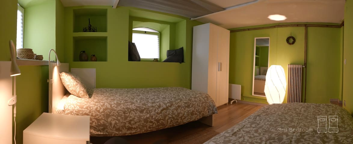 The third bedroom. Features two single beds also with an anatomical mattress and upper mattress for extra comfort, quality all cotton beddings and relaxing colors. All beds in the house have freshly washed waterproofing covers for the mattresses.