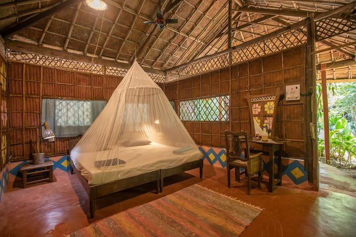 The Double bedroom with attached bathroom on the ground floor with a Varanda.
