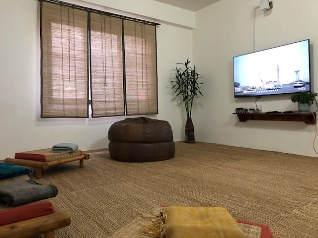 The den carpeted in handwoven natural grass mat and furnished with all locally sourced products is a perfect place to relax.  Catch your favorite shows  or simply lay and stretch.