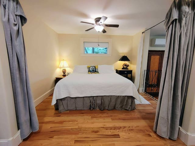 Comfortable King size bed. You can lay in bed and look through the studio and out the big glass windows or you can pull the curtains for privacy.