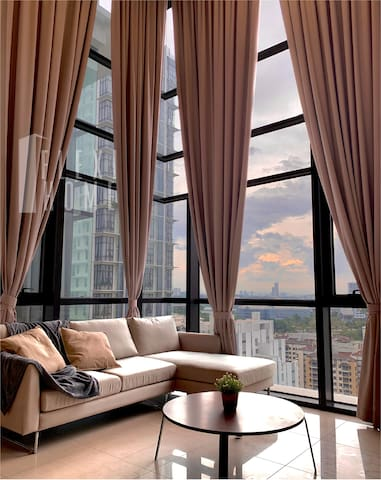 Living Room with 3-Seater Soft Sofa with Comfy Pillows and  Huge Window for City View