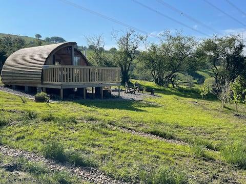Cabanau Bach- Una acogedora estancia en cabaña en las colinas galesas