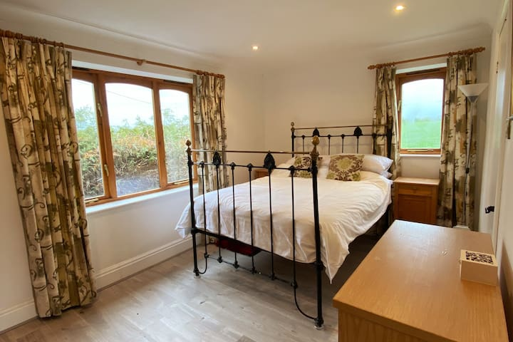 Master bedroom on the ground floor with views over the fields