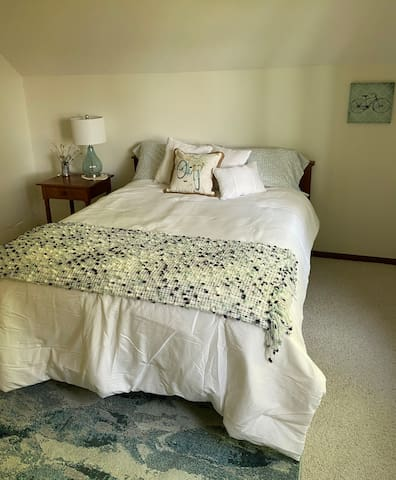 Queen size bed on second floor with lovely view of lake.
