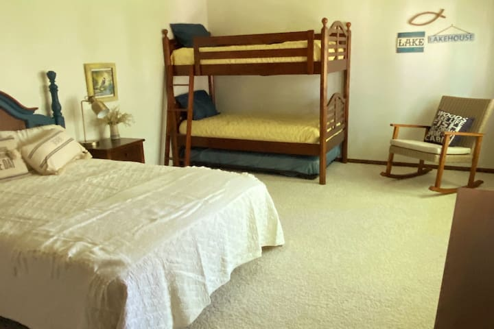 Extra large bedroom for family. It has a queen bed and bunk bed with trundle bed. Suggested for 2 Adults & 3 children.