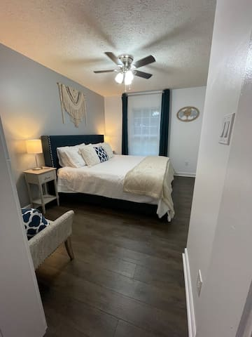 """Main bedroom downstairs (King), for those early evenings you can always watch a movie in bed on the 42"""" Roku TV"""