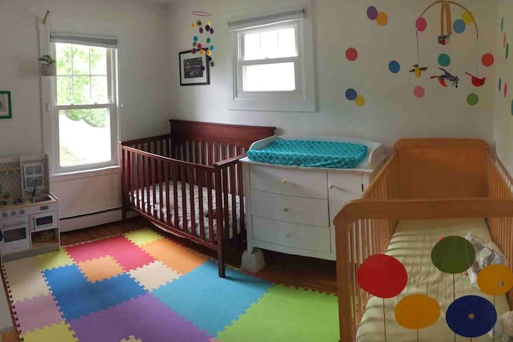 Second bedroom has two cribs. One crib can be converted to toddler bed if needed. Also changing table, and dresser.