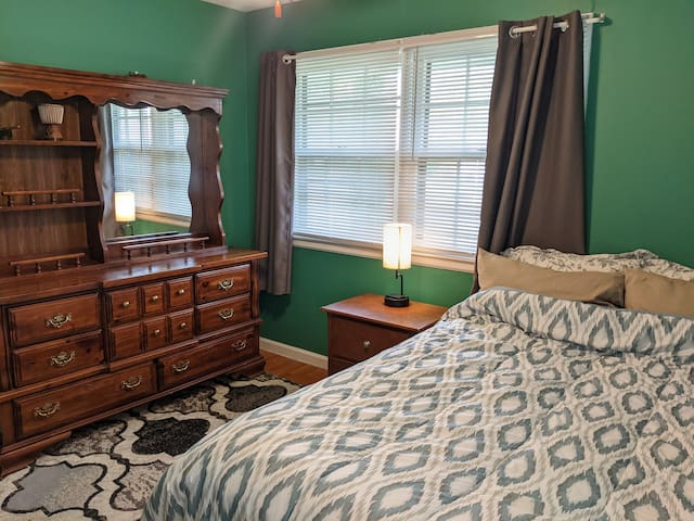 1st bedroom with a comfortable queen bed and blackout curtains for a better sleep.