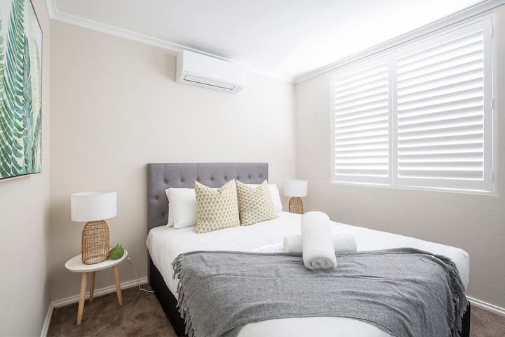 The third bedroom is fitted with a premium queen-sized bed and topped with luxury linens to ensure a good night's sleep.