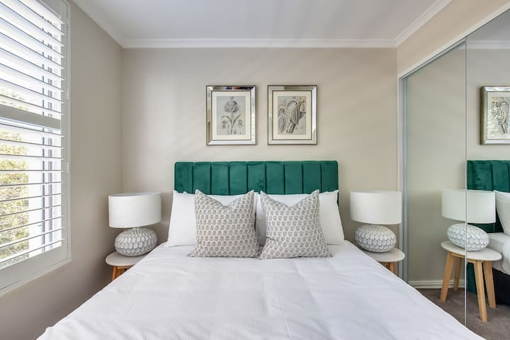 The light-filled second bedroom also benefits from a premium queen-sized bed and has a mirrored wardrobe for your belongings.