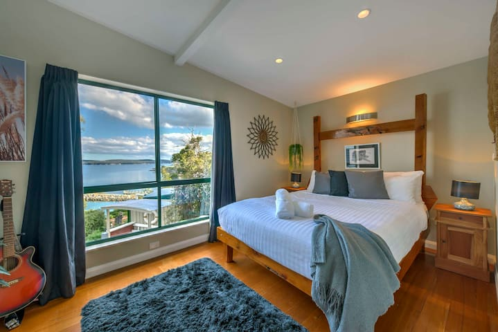 The main bedroom has stunning ocean views and comfortable bed.
