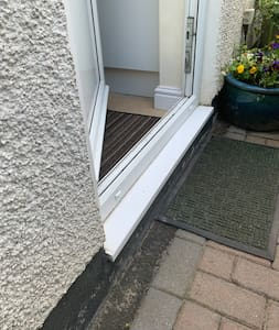 Step to access the BedHaus Private Annex, Height from Paving Blocks to Top Edge of Door Frame.. 24cm.