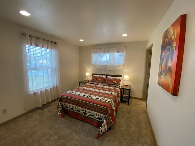 Guest bedroom, queen bed and private bathroom.