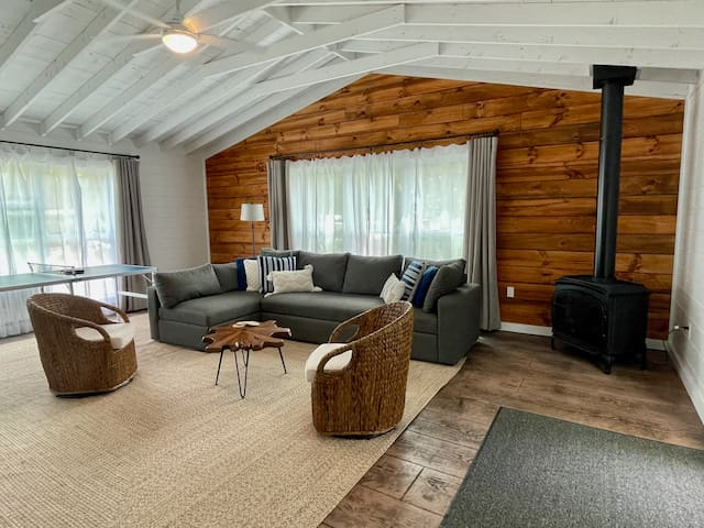 """The heart of the house -- a great room with sectional couch, remote control gas fireplace, mini ping pong table, and 75"""" HDTV"""