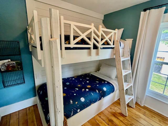 Bedroom with extra-long twin beds and closet